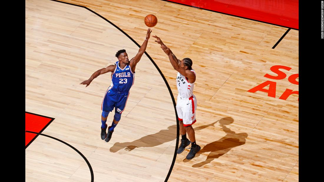 Jimmy Butler of the Philadelphia 76ers, left, contests a shot by Kawhi Leonard of the Toronto Raptors during Game Two of the NBA Eastern Conference Semifinals on Monday, April 29, at Scotiabank Arena in Toronto.