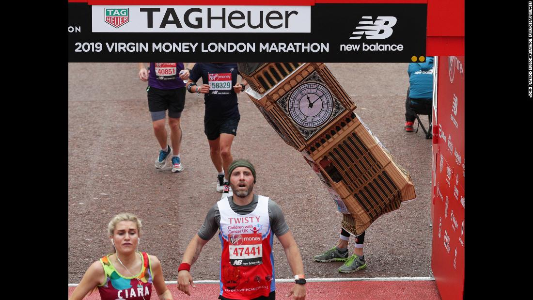 "Marathon runner Lukas Bates, dressed in a Big Ben costume, attempts to fit under the finish line of the <a href=""https://edition.cnn.com/2019/04/29/sport/london-marathon-2019-best-stories-spt-intl/index.html"" target=""_blank"">London Marathon</a> on Sunday, April 28."
