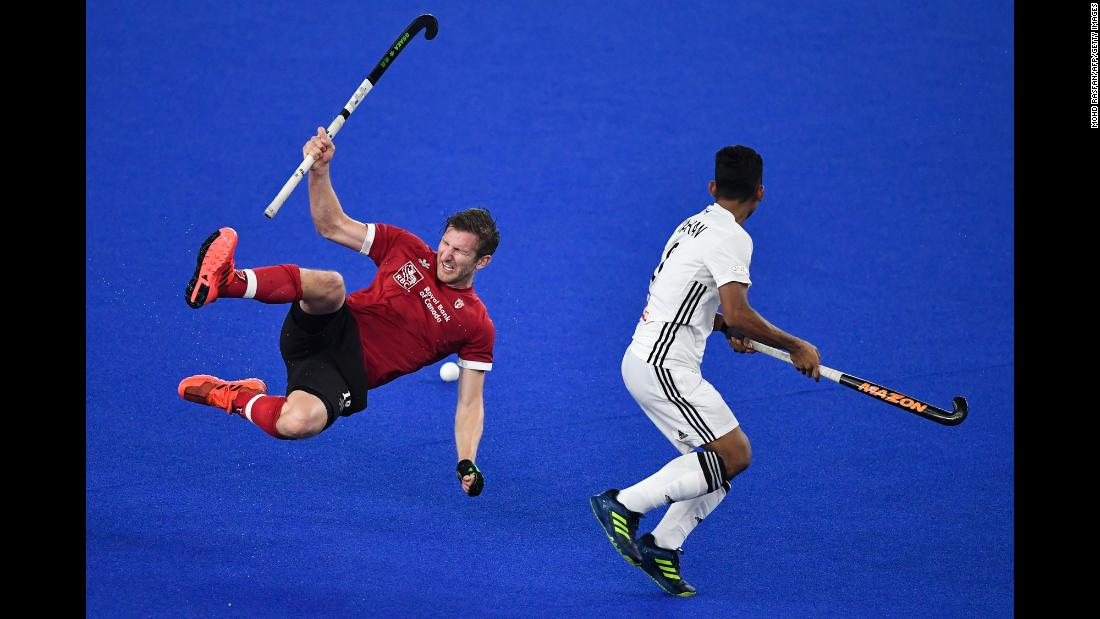 Canada's Mark Pearson, left, falls while competing for a loose ball with Malaysia's Marhan Jalil during the FIH Men's Series Finals field hockey match between Malaysia and Canada on May 4 in Kuala Lumpur, Malaysia. The match was part of a qualifying tournament for the Tokyo 2020 Olympics.
