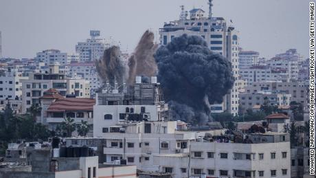 Smoke is sen rising after an Israeli air raid on homes in Gaza City.