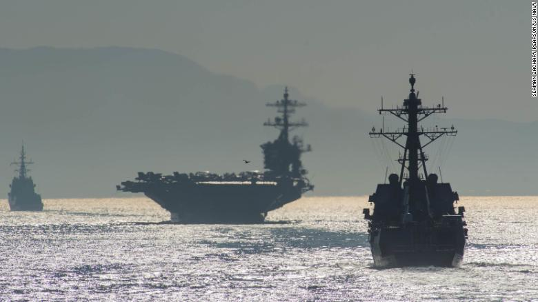 The Arleigh Burke-class guided-missile destroyer USS Bainbridge, right, the Nimitz-class aircraft carrier USS Abraham Lincoln, and the Spanish navy Alvaro de Bazan-class frigate ESPS Méndez Núñez transit the Strait of Gibraltar, entering the Mediterranean Sea.