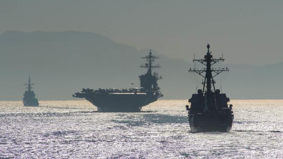 The guided-missile destroyer USS Bainbridge, right, and the  USS Abraham Lincoln transit the Strait of Gibraltar, entering the Mediterranean Sea, in April.
