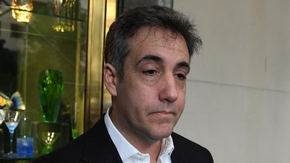 Michael Cohen, the former lawyer for US President Donald Trump, talks to the press as he leaves his Park Avenue apartment May 6, 2019 in New York City to begin serving a three-year sentence at a federal prison in Otisville, New York. - After dramatic appeals and testimony in Congress, Donald Trump's one-time personal lawyer Michael Cohen reports to jail Monday, May 6, 2019 to serve a sentence he deems unjust because he was simply following his boss's orders. (Photo by TIMOTHY A. CLARY / AFP)        (Photo credit should read TIMOTHY A. CLARY/AFP/Getty Images)