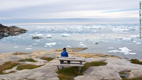 A man takes in  the view over the Ilulissat ice fjord and the Disko Bay in west Greenland.