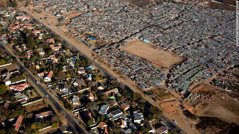 In South Africa, the divide between rich and poor is visible from the sky. On the left is Bloubusrand in Johannesburg, a middle class area with larger houses and pools. On the right is Kya Sands informal settlement.