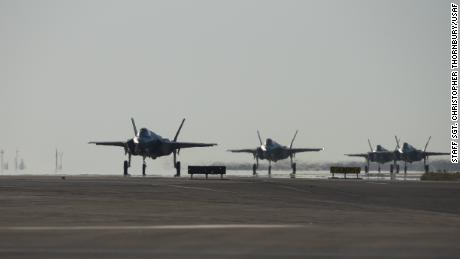 Four US Air Force F-35As taxi after landing at Al Dhafra Air Base, United Arab Emirates, on April 15, 2019.