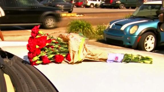 Biloxi Police Chief John Miller placed flowers on a patrol vehicle in tribute to fallen officer Robert McKeithen.