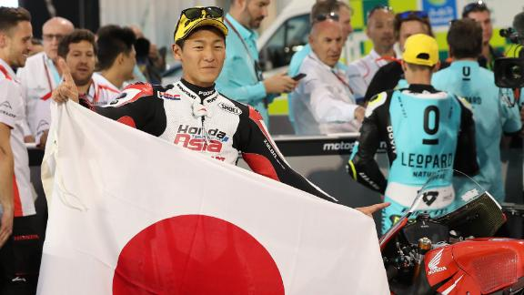 Kaito Toba, pictured holding a Japanese flag, has come through the ranks of Moto GP.