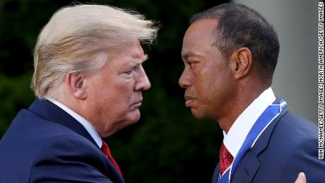 President Donald Trump presents professional golfer and business partner Tiger Woods with the Medal of Freedom during a ceremony in the Rose Garden at the White House May 6, 2019.