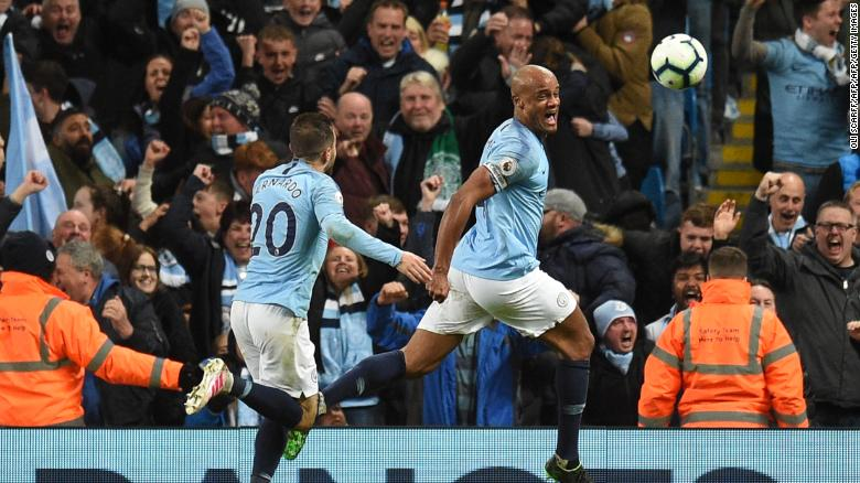 Vincent Kompany celebrates scoring the winning goal against Leicester City.