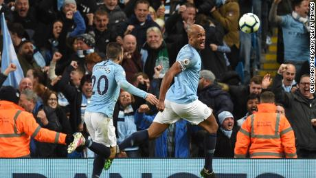 Vincent Kompany celebrates scoring in his side's dramatic victory over Leicester.