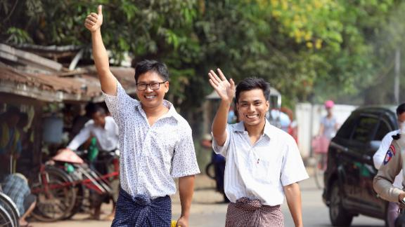Reuters reporters Wa Lone and Kyaw Soe Oo gesture as they walk free outside Insein prison after receiving a presidential pardon in Yangon, Myanmar, May 7, 2019. REUTERS/Ann Wang