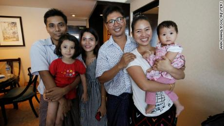 Wa Lone poses with his wife Pan Ei Mon and his daughter, along with his reporter colleague Kyaw Soe Oo, who wore his daughter next to his wife Chit Su Win.