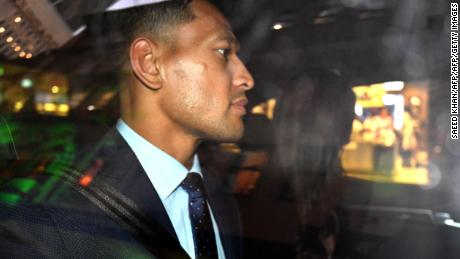 Folau leaves a code of conduct hearing in Sydney.