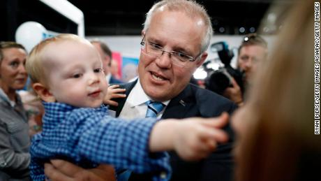 Scott Morrison, Prime Minister of Australia, holds a baby during a Liberal Party Campaign Rally at Launceston Airport on April 18, 2019 in Launceston, Australia.
