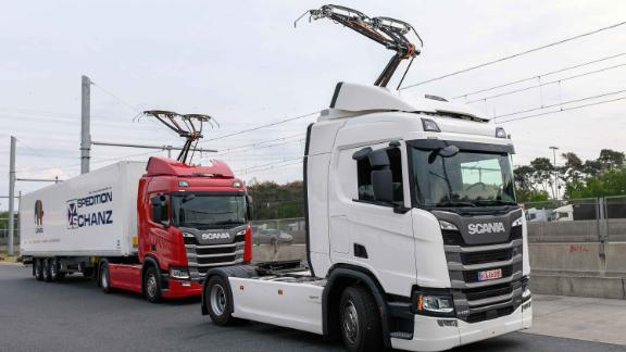 07 May 2019, Hessen, Darmstadt: Two Scania R450 Hybrid tractors with extended pantograph are about to start operating the first German test track for electric trucks with overhead contact line at a service area on motorway 5 (A5). The eHighway will be tested in public road traffic for the first time on the 10-kilometer test track between the Langen/Mörfelden and Weiterstadt junctions. Photo: Silas Stein/dpa (Photo by Silas Stein/picture alliance via Getty Images)