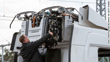 A technician works on a big rig before the tests commence.