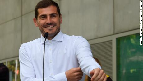 Iker Casillas smiles as he addresses journalists after leaving a hospital in Porto on Monday.
