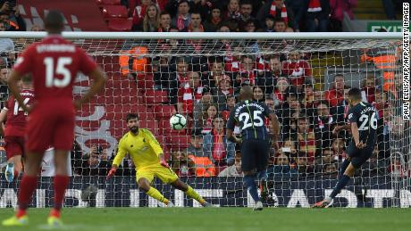 Manchester City's Riyad Mahrez (R) shoots from the penalty spot but fails to score during last season's 0-0 draw at Anfield.
