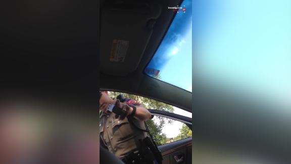 A weapon is pointed at Sandra Bland, her cell phone video of her July 2015 arrest shows.