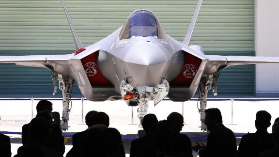 This picture taken on June 5, 2017, shows the first F-35A stealth fighter assembled in Japan, unveiled at a Mitsubishi Heavy Industries factory in Toyoyama.