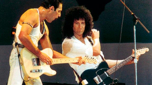 Freddie Mercury and Brian May play Live Aid in 1985.