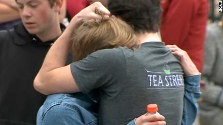 Students at the STEM school hug Tuesday after two suspects opened fire inside the school.