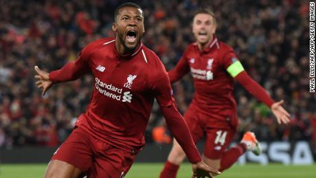 Liverpool's Dutch midfielder Georginio Wijnaldum celebrates after scoring their third goal during the UEFA Champions league semi-final second leg football match between Liverpool and Barcelona at Anfield in Liverpool, north west England on May 7, 2019. (Photo by Paul ELLIS / AFP)        (Photo credit should read PAUL ELLIS/AFP/Getty Images)