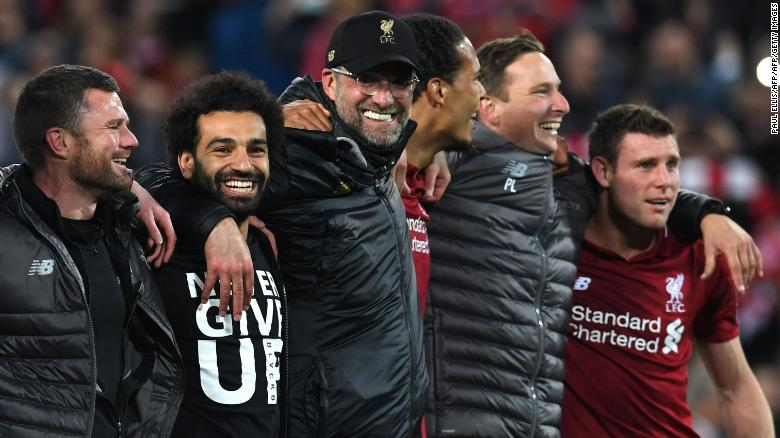 Mohamed Salah and Jurgen Klopp take in the adulation of the fans.