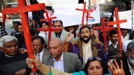Members of the Christian Democratic Pakistan Alliance march during a protest action in Lahore on December 25, 2010. in support of Asia Bibi