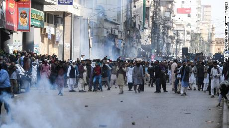 Pakistani Islamists react after police use tear gas during a period of investigation Against the decision of the Supreme Court in the Asia Bibi case.