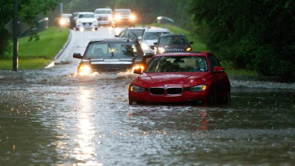 Vehicles wade through flooded Kingwood Drive as thunderstorms hit the Kingwood area Tuesday, May 7, 2019, in Kingwood, Texas. Heavy rain is battering parts of southeast Texas prompting flash flood warnings, power outages and calls for water rescues.  (Jason Fochtman/Houston Chronicle via AP)
