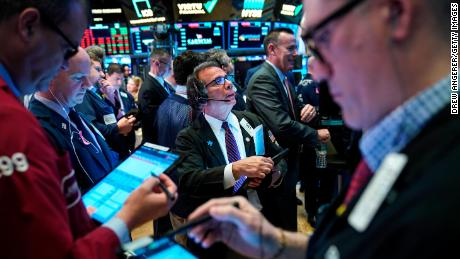 NEW YORK, NY - MAY 8: Traders and financial professionals work on the floor of the New York Stock Exchange (NYSE) ahead of the opening bell, May 8, 2019 in New York City. The Dow Jones Industrial Average fell about 33 points on Wednesday morning following a 470-point loss in the previous day's trading session. Recent volatility in the markets is driven by trade uncertainties between the United States and China. U.S. President Donald Trump said he is hopeful for a trade deal as a Chinese delegation arrives in Washington later this week for further trade negotiations. (Photo by Drew Angerer/Getty Images)