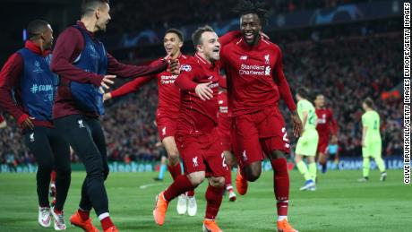 Divock Origi of Liverpool celebrates as he scores during UEFA Champions League game against Barcelona.