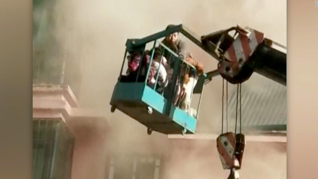 Teenage crane operator saves 14 people trapped by fire
