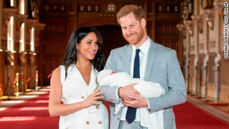 Britain's Prince Harry and Meghan, Duchess of Sussex, hold their newborn son, in St George's Hall at Windsor Castle on Wednesday.