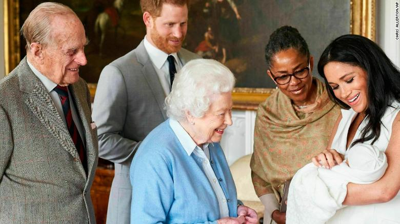 Britain's Prince Harry and Meghan, Duchess of Sussex, joined by her mother Doria Ragland, show their new son to Queen Elizabeth II and Prince Philip at Windsor Castle.