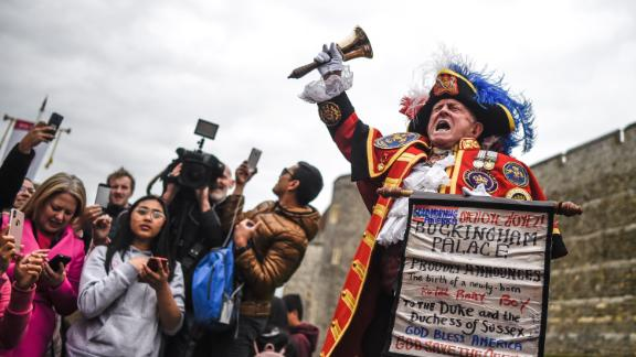 Unofficial town crier Tony Appleton welcomes the baby's birth outside Windsor Castle on Monday, May 6.