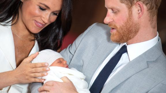 Prince Harry, Duke of Sussex and Meghan, Duchess of Sussex, pose with their newborn son Prince Archie Harrison Mountbatten-Windsor during a photocall in St George