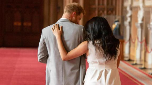 The couple leaves after posing for photos on Wednesday.