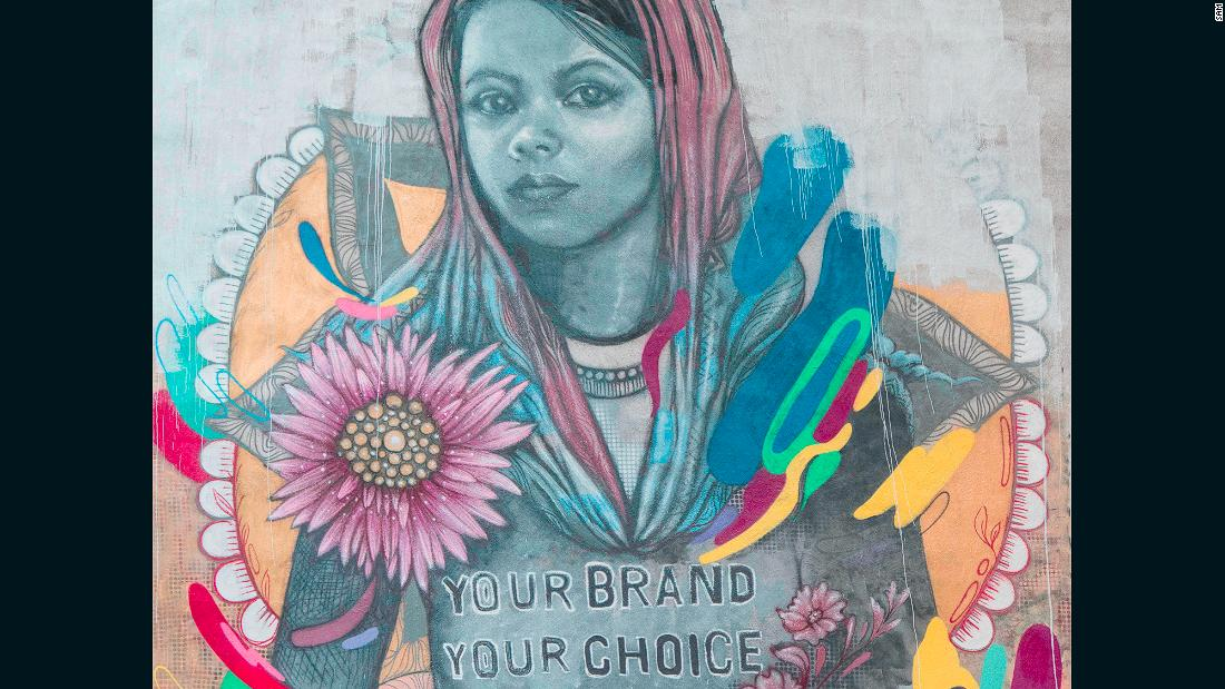 This mural represents the problem of child labor in the fashion industry in Bangladesh. It tells the story of Bithi, who says she was sent to work in a factory at the age of 12, helping to make designer jeans. According to World Vision, who provided her account to SAM, she helped to make 480 pairs of jeans a day, for which she was paid just over $1. The mural on 28 Cliff Street was painted by Mexican street artist KinMx.