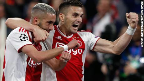 Hakim Ziyech (L) celebrates with teammate Dusan Tadic after scoring Ajax's second.
