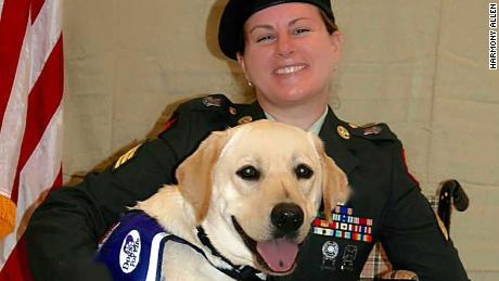 "Harmony Allen in uniform with her service dog ""Gunny"" at a military event in Port St. Lucie, FL in 2016."