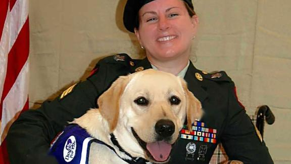 """Harmony Allen in uniform with her service dog """"Gunny"""" at a military event in Port St. Lucie, FL in 2016."""