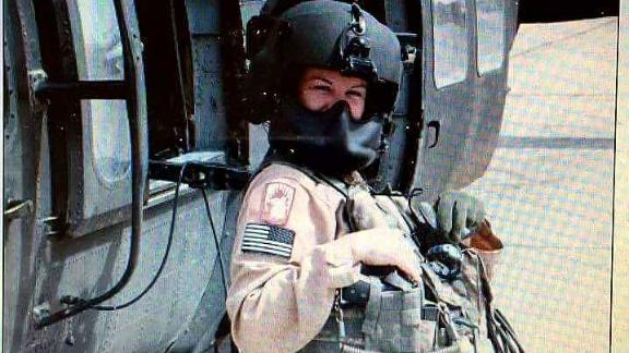 Harmony Allen with a Black Hawk helicopter during her Army training in 1999 at Fort Benning in GA. Allen served in the Army before joining the Air Force in 2000.