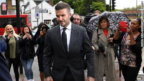 David Beckham leaves a court in southeast London after being banned from driving for six months.