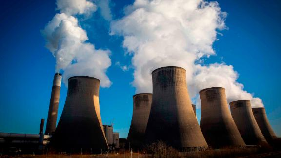 Smoke and steam bellows from the chimneys and cooling towers of Ratcliffe-on-Soar coal fired power station.