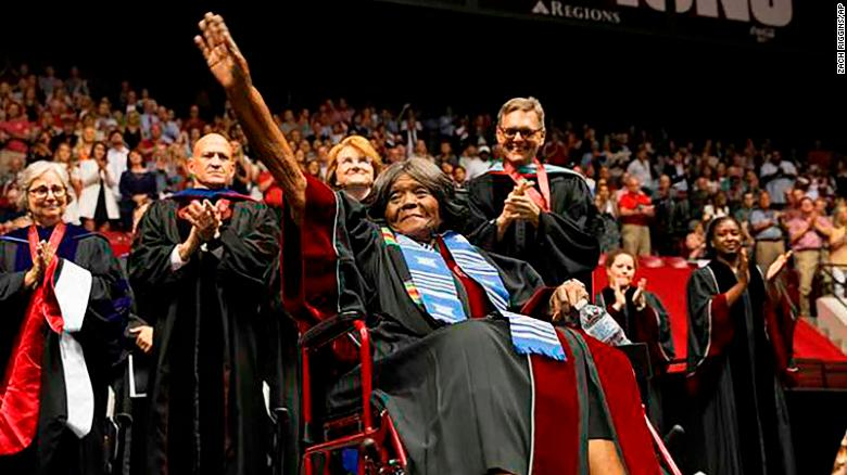 Autherine Lucy Foster acknowledges the crowd as she receives an honorary doctoral degree during a commencement exercise last week at the University of Alabama.