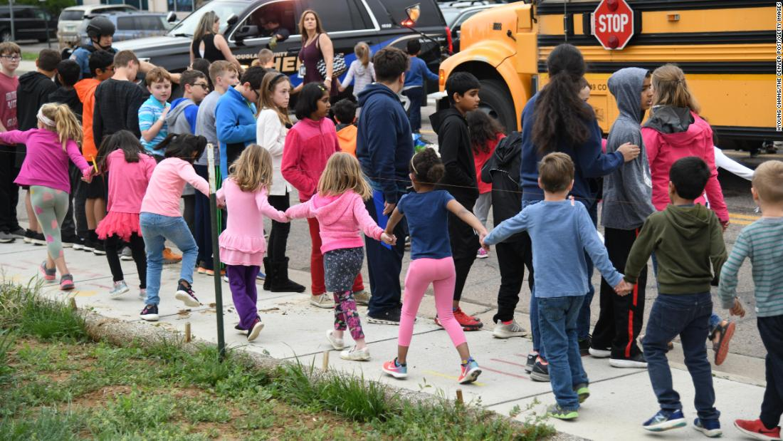 "Students are escorted to buses following <a href=""https://www.cnn.com/2019/05/08/us/gallery/denver-school-shooting-may-2019/index.html"" target=""_blank"">a shooting at their school</a> in Highlands Ranch, Colorado, on Tuesday, May 7. One student, 18-year-old Kendrick Castillo, <a href=""https://www.cnn.com/2019/05/08/us/kendrick-castillo-denver-stem-shooting/index.html"" target=""_blank"">was killed</a> trying to stop the shooting. Eight other students were wounded. Two suspects, both students, <a href=""https://www.cnn.com/2019/05/08/us/denver-stem-school-shooting-wednesday/index.html"" target=""_blank"">are in custody.</a>"