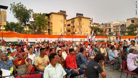 Supporters of the main opposition Congress Party wait for leader Rahul Gandhi's New Delhi rally.